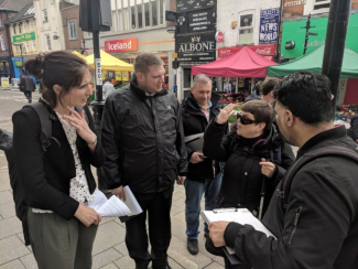 Member of the mobility forum talking to candidates in Croydon