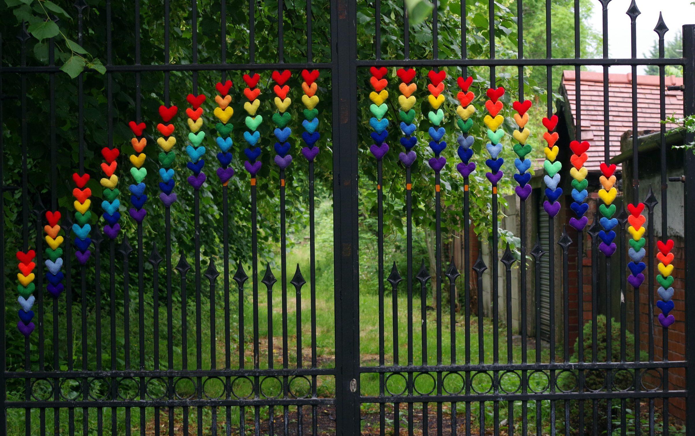 Rainbow stuck to gates of garden