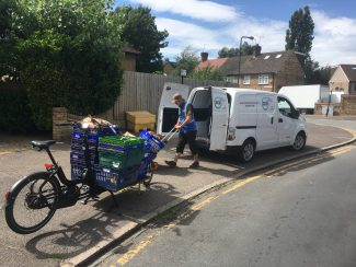 A man loads up a cargo bike, communities of practice: high streets