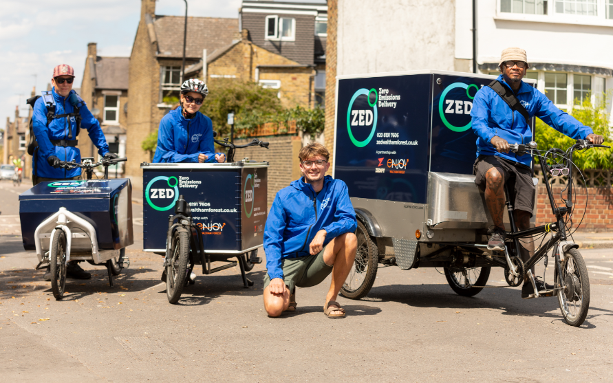 Staff pose with cargo bikes
