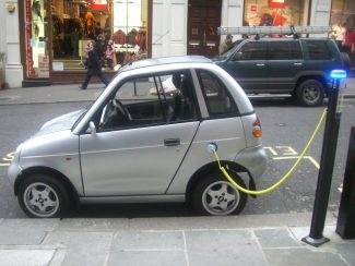 Electric car charging on a street