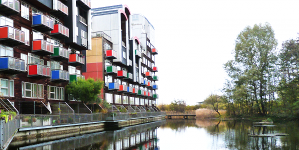 Achieving Net Zero conference, housing by water image