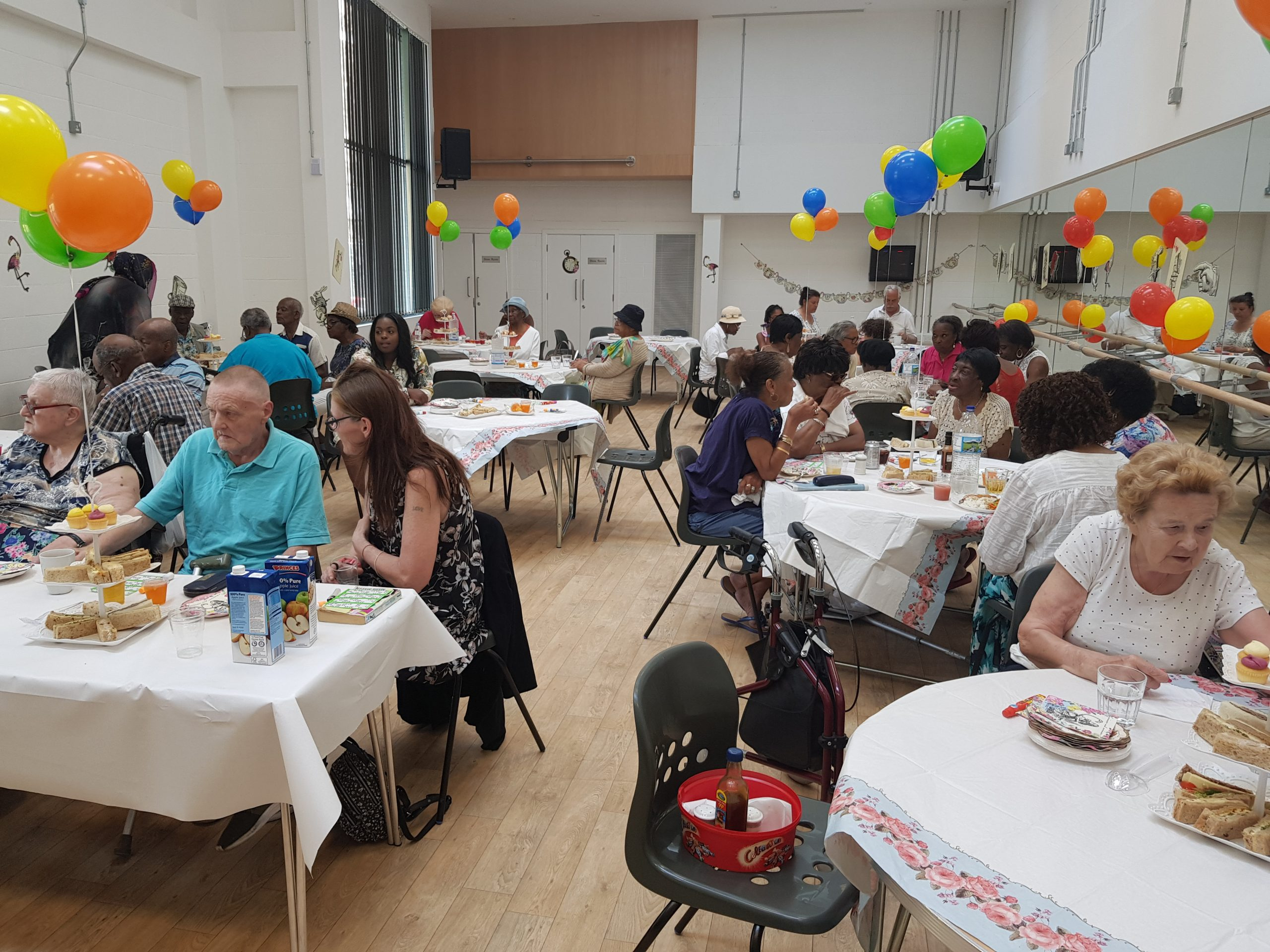 Local residents having a meal in the Community hub before Covid-19.