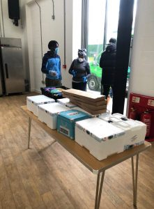 Food parcels on a table in the community hub ready to be delivered during Covid-19
