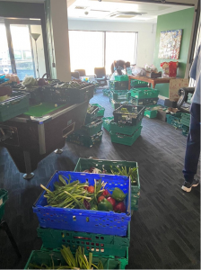 Crates of donated food in the hub for the local community during Covid-19