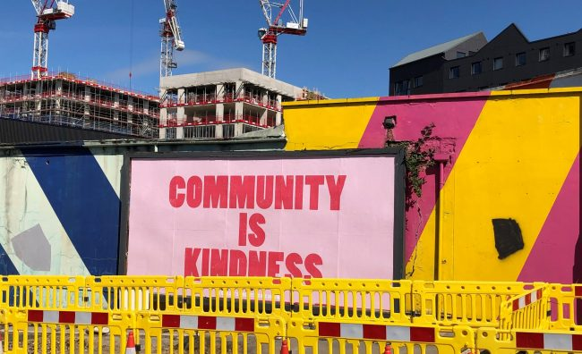 Billboard reading community is kindness. #LearningFromCrisis: Creating better use of public assets